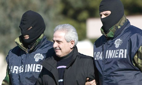Pasquale Condello is led away by Italian police