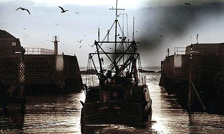 A fishing boat heads out to sea at Eyemouth harbour, in the Scottish Borders