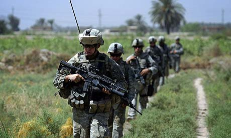 US troops conduct a foot patrol along the Tigris river south of Baghdad, Iraq