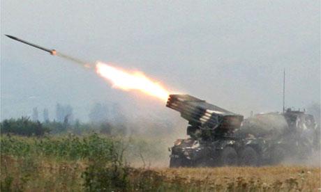 A Georgian launcher fires rockets at rebels near the South Ossetia capital, Tskhinvali