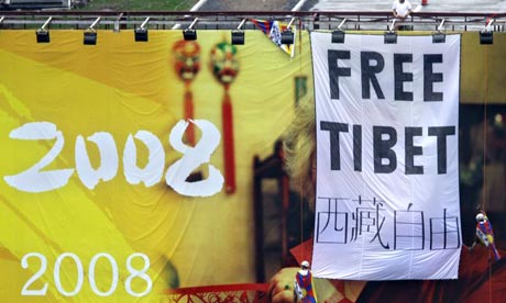 Pro Tibet activists unfurl a