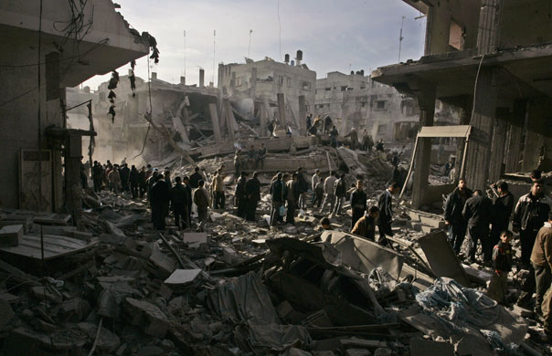 Palestinians inspect damage in Gaza, Jan. 14. The Guardian