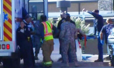 Medics put a injured person into an ambulance after shooting at Fort Hood, Texas.