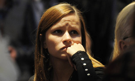A woman listens to Barack Obama's speech at Copenhagen climate change conference 18 December 2009