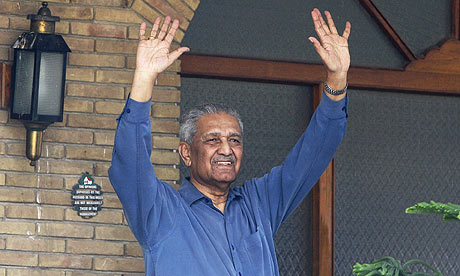 Pakistani nuclear scientist Abdul Qadeer Khan waves after his release from house arrest in Islamabad