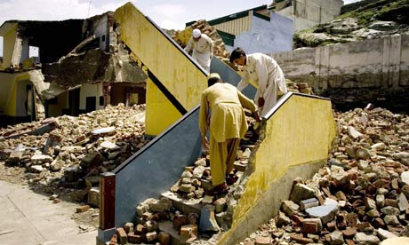 Students in Mingora sift through the rubble of their school allegedly destroyed by Taliban militants