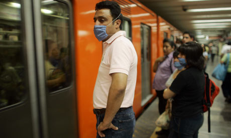 People wearing surgical masks against swine flu in the Mexico City subway guardian.co.uk