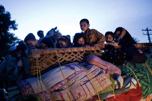 Swabi, Pakistan: Buner refugees travel by road as they flee fighting (Daniel Berehulak/Getty Images)