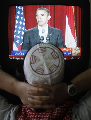 A man in a Palestinian refugee camp in Amman watches the US Presidents address to the Middle East and Muslims June 4th.