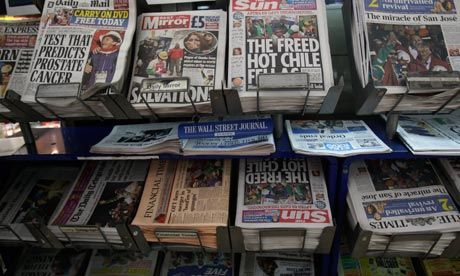 Newspapers headlining the rescue of Chilean trapped miners