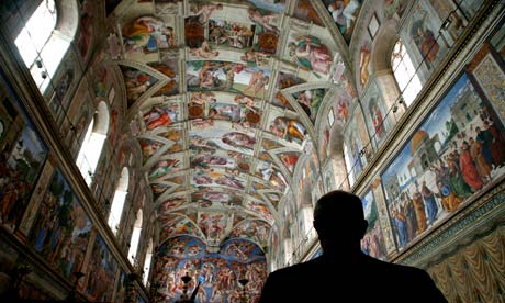 A visitor to the Sistine chapel admires Michelangelo's  frescoes