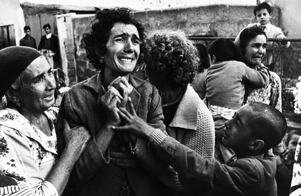 Cyprus, 1964: A grieving woman and her family