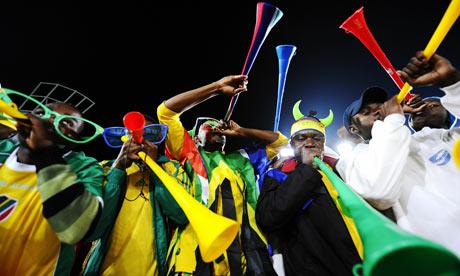 South African fans play vuvuzelas