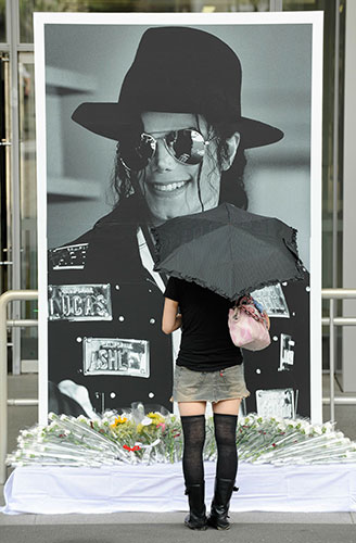 Michael Jackson memorials: A Japanese fan prays in front of a 