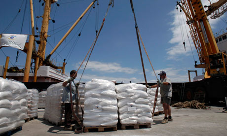 Workers load supplies on Amalthea at Lavrio,near Athens bound for Gaza