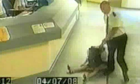 CCTV footage of police sergeant Mark Andrews dragging Pamela Somerville through the police station