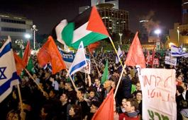 Israeli and Palestinian flags are waved by thousands of activists from leftwing groups in Tel Aviv