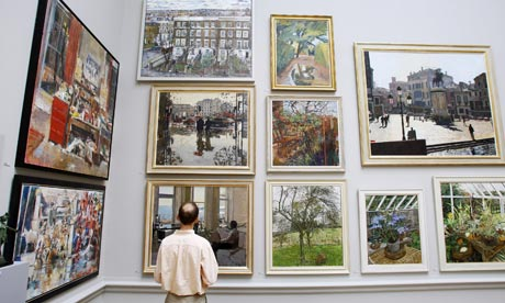 Man looks at paintings