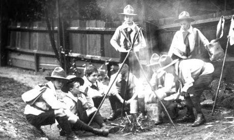 From The Guardian:  British boy scouts around a fire, 1910
