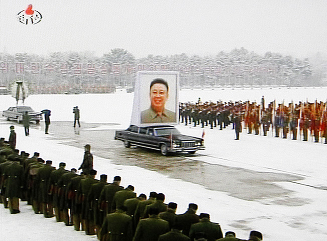 Kim Jong-il funeral: A portrait of Kim Jong Il is carried during his funeral procession