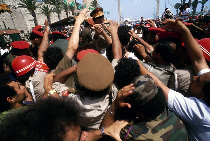 Muammar Gaddafi : Gaddafi appears at a parade in 1987 to commemorate the 18th anniversary of the Libyan revolution