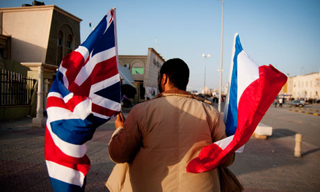 Libya's European ties … a man holds a British and a French national flag in Benghazi. Photograph: Manu Brabo/EPA
