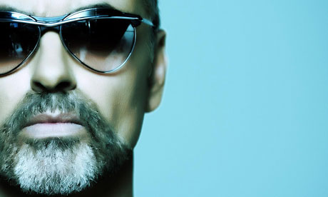 A picture of george michael wearing sunglasses