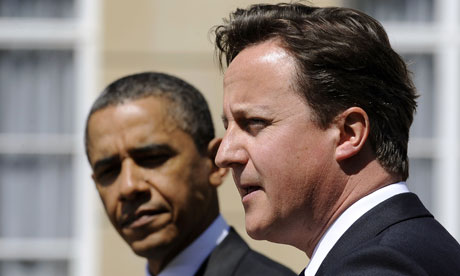 Barack Obama listens asDavid Cameron speaks during a joint press conference at the Lancaster House