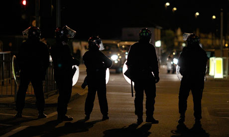 Police in riot gear in Enfield, north London, on Sunday night