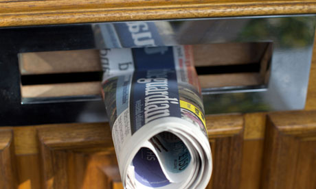 The Guardian newspaper in a letterbox