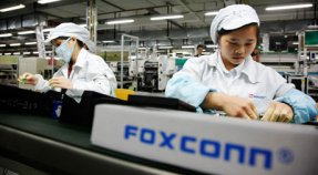 Employees work on the assembly line at the Foxconn plant in Shenzhen, China