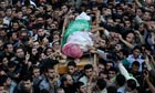 Palestinian Hamas members carry the body of Ahmed al-Jabari during his funeral in Gaza City