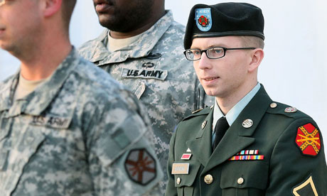 Bradley Manning is escorted away from his Article 32 hearing