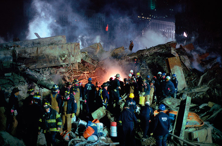 Joel Meyerowitz Monograph: Fire fighters work at the foot of the collapsed World Trade Centre
