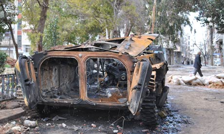 Syria crisis – an Assad regime military vehicle destroyed by rebels