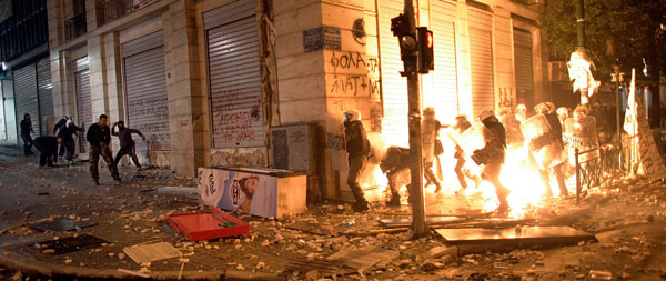 Greek demonstrators throw fire bombs at riot police during violent protests in central Athens