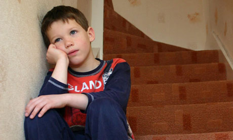 Unhappy boy sitting on stairs