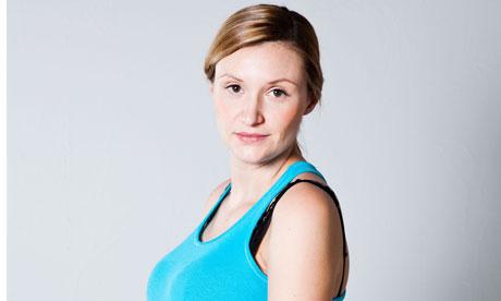 Portrait of a beautiful pregnant woman looking at camera. Studio shot.