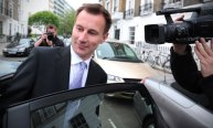 Jeremy Hunt leaves his central London home before giving evidence to the Leveson inquiry