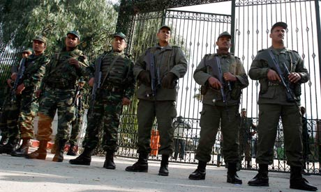 Tunisian soldiers stand guard outside the national assembly