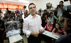 Alexis Tsipras is seen in a polling station after voting in Athens 17 June