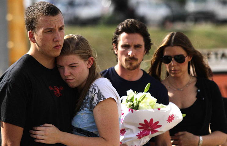 baleaurora: Two young mourners at Aurora memorial with Christian Bale and Sibi Blazic