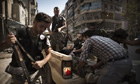 Syrian rebels help a wounded comrade
