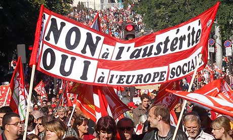 Protesters carry a banner reading 'no to austerity'