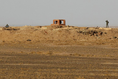Moroccan soliders stand by a desert fortification in Western Sahara