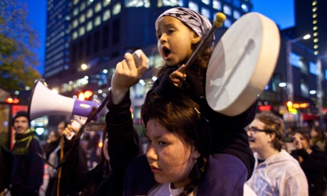 A girl plays the drums as she sings a traditional First Nations song during an anti shale gas demonstration in Montreal in support of the Mikmaq people of Elsipogtog First Nations in New Brunswick.