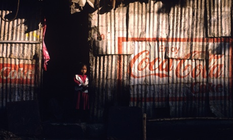A young girl takes to an abandoned building for the shade in Mumbai, India.