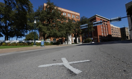 In this file photo, an X marks the spot on Elm Street where the first bullet hit President John F Kennedy. The Xs on the street  are gone.