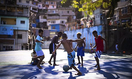 Boys play football in the Borel favela