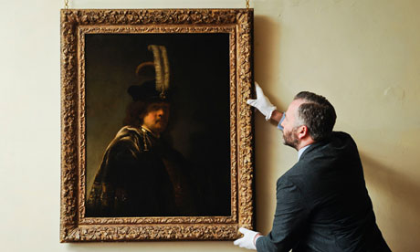 The newly discovered Rembrandt self-portrait is inspected by the curator David Taylor at Buckland Abbey. Photograph: Ben Birchall/PA